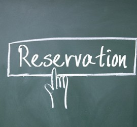 finger click reservation symbol on blackboard